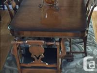 This beautiful antique dining room set has been in out