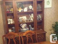 This is a solid wood table, 6 chairs and buffet/hutch.