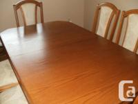 This OAK DINING ROOM TABLE comes with 6 upholstered