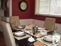 - Beautiful wood dining room table and four chairs. -