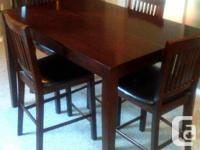 Dining room table with 6 chairs, leaf, and lazy susan