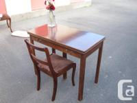 This solid wood dining room table set includes 6 chairs