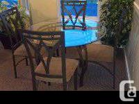 Classy round beveled glass dining room table with 4