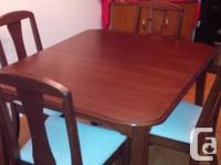 Beautiful, MINT, solid wood dining room table, with 2