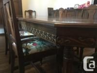 Very ornate old dining room table with 3 leaves, 5