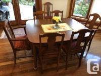 We have a dining room set consisting of a table with 3