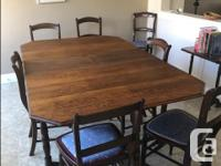 Antique table and 7 chairs, the table has fold down