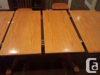 Large oak veneer dining room table. Has 2 leafs. One for sale  British Columbia