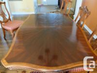"Beautiful solid wood table with in-laid surface. 72"" x"