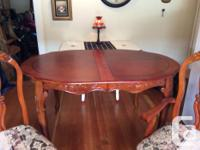 Almost new dining set.2 captains chairs and 4 regular