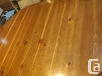Solid wood dining table with 1 leaf. 4 chairs (one is a