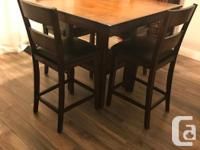 One year old bar height dining set with table and 4