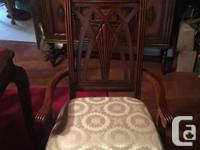 Table, 6 chairs and cabinet. In excellent condition,