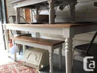 Custom built harvest table with rough cut wood top.
