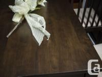 Table is a dark wood in excellent condition. Comes with