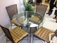 Beautiful glass top dining table with 4 matching