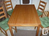 Excellent condition IKEA solid wood dining table and 4