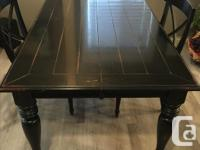 We have a dining table for sale, that comes with two