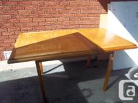 Antique solid wood dining table for sale. No chairs.
