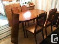 DINING TABLE WITH 4 CHAIRS AND EXTRA LEAF AND HUTCH.