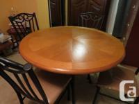 Wooden kitchen area table with dark steel legs.