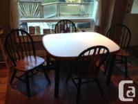 Well made strong table with laminate top. Includes