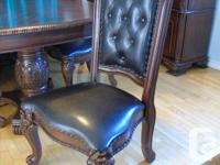 Beautiful elaborately carved two pedestal dining table