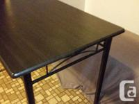Selling a black dining table. Measurements are 43-1/2""