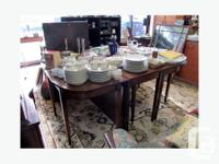 Large Dining Table with 1 Leaf and 1 drop leaf. Can be