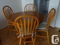 Solid maple with 4 chairs with cushions 42 inch round 2