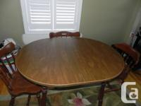 """Wooden oval dining table with 4 chairs. 60"""" long X 36"""""""