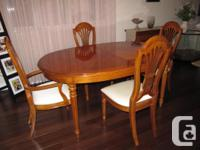 "(1) Oval table 66"" x 45� with two extra 16"" leaves (2)"