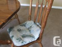 Dinning Room Table and Chairs. Two are Capitan chairs