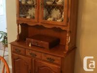 Maple table, chairs, hutch and buffet in this set. The