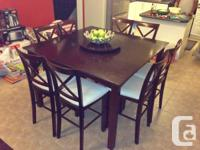Dinning table with 8 chairs. Mahogany. Call: