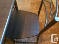 Hi i m selling BLACK wood/metal dinning table with 4