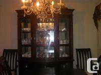 beautiful set of a dinning table with 6 chairs, buffet