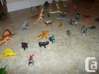 An assortment of dinosaurs and bugs for hours of play