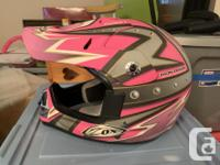2 ZOX dirt bike helmets slightly used, (both youth