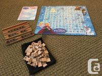 Scrabble board game for ages 4+. It is a 2-sided board