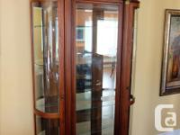 Uniquely styled display cabinet. Glass front, curved