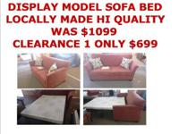 Clearance price on our display model Love seat hide a