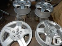Dodge Caliber 17 inch stock alloy rims. Refinished.