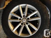 4 winter tires on alloy rims with wheel nuts and