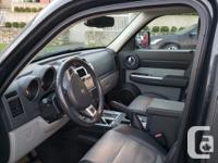 Make Dodge Model Nitro Year 2010 Colour dark grey kms