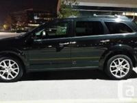Make Dodge Design Trip Year 2013 Colour Black kms