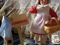 This is a charming little porcelain doll from The