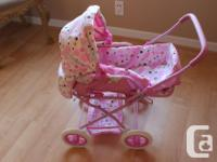 You & Me brand adjustable doll pram and carrier. Pram