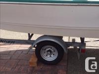 15 feet, with road runner trailer, 50 hp Nissan motor,
