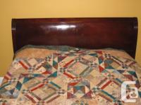 This classic double sleigh bed frame is about 60 years
